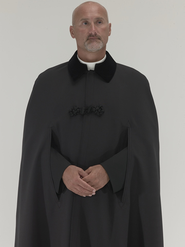 Black 100% Polyester Cloak with full satin lining, black velvet collar, black piping and large frog closure